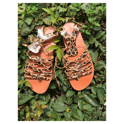LACE UP LEOPARD SANDALS.