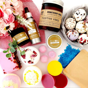 Collection of bath bombs, candles, skincare and pampering products.
