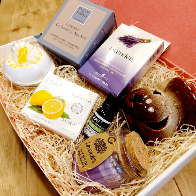 Our lemon & lavender hamper with its selection of gifts including candles, incense, bath bomb, oil burner, essential oil and paper soap.