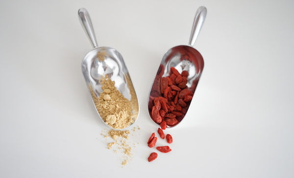 adaptogen herbs: goji berries and eleuthero powder