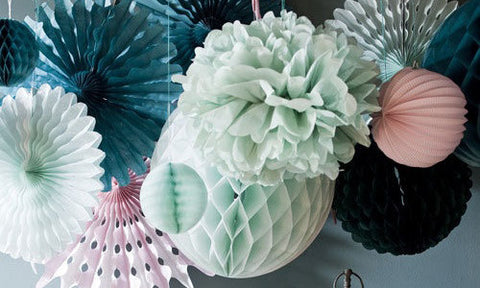 Paper honeycomb balls mixed with pinwheels