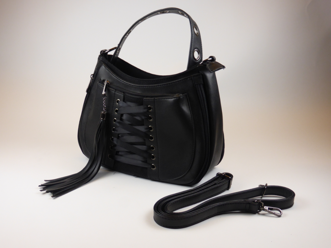 King Cobra Store rock and metal handbag in black with corset ribbon detail detachable shoulder strap inner organizing pockets with zipper and cellphone holder  extendable depth by 2 zippers on front and backside.