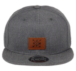 Load image into Gallery viewer, King Cobra Store Snapback Baseball cap in Twill flat brim flat visor squared visor in black brown grey stitched eyelets 6 panel high shape front panel adjustable PVC closure to fit all one size square brown leather arrow KCMP patch logo