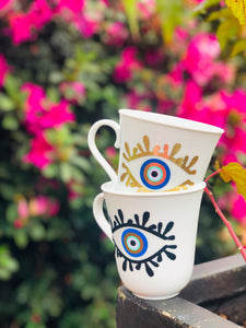 evil eye coffee mugs