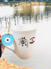 Load image into Gallery viewer, Evil Eye face With your name  Hamsa Hand Coffee Mug With Your Name Evil Eye