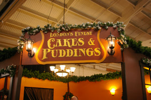 London's Finest Cakes and Puddings sign at the Great Dickens Christmas Fair