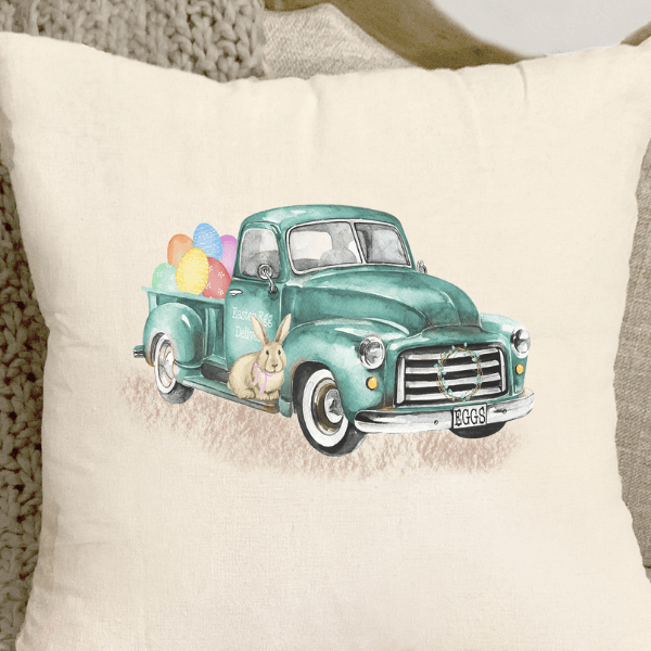 Easter themed pillow cover with bunny and eggs on a blue pickup truck