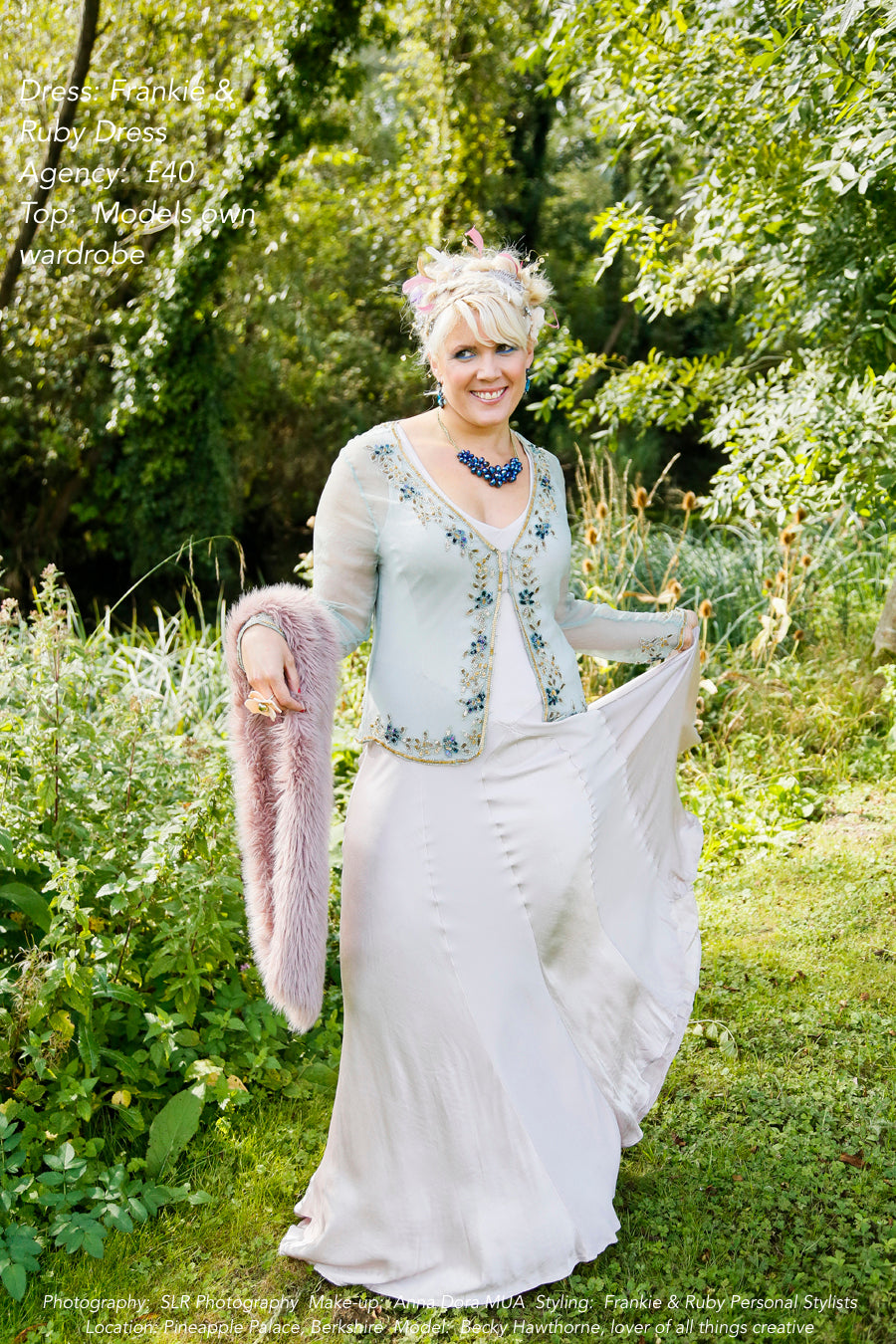 A model in a floaty dress wearing secondhand clothes
