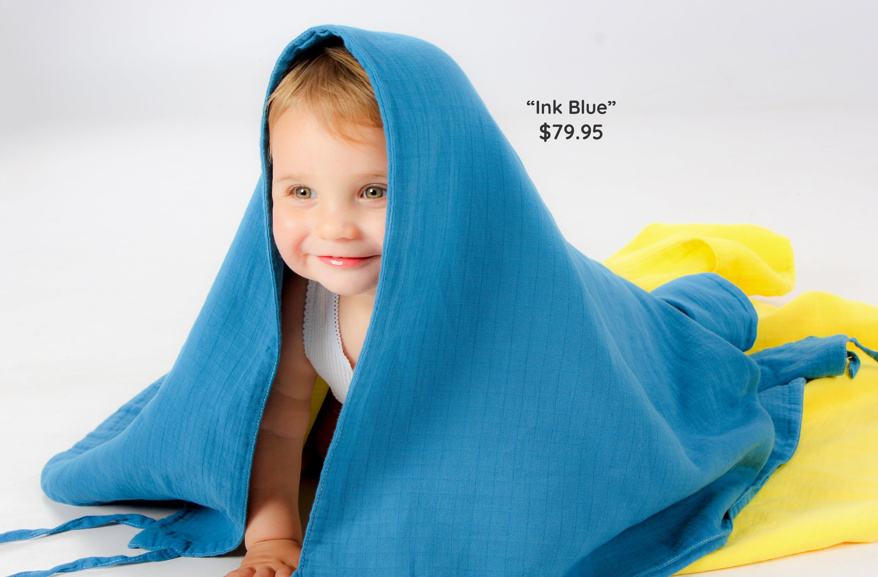 Baby with blue musluv hood