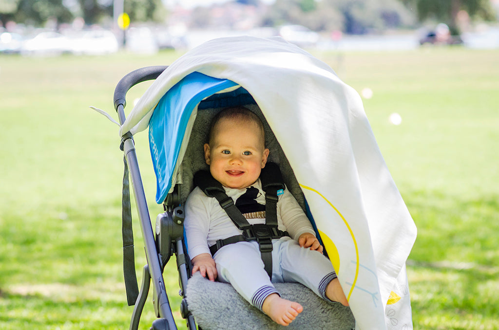 Baby looking out of covered pram