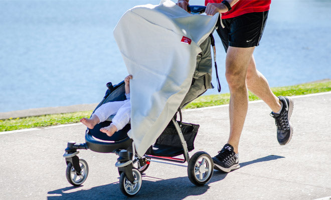 Dad running with musluv baby sun shade as a stroller sun protector