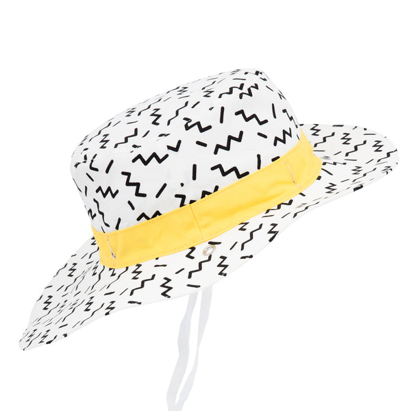 Side view of white children's sun hat with black zig zag repeat motif and yellow band