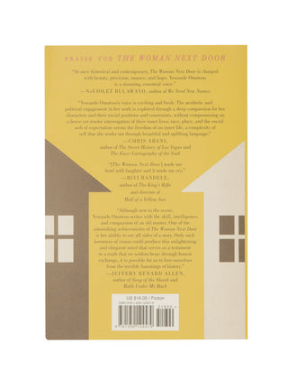 The Woman Next Door paperback book