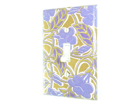 A large bluish purple floral design covers this single toggle swtich plate, with a metallic gold background weaving in and out of the tan leaves and vines.