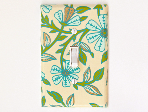 Teal Flowers cover this Cream colored Single Toggle Switch Plates, with Green and Gold Leaves by The Orange Chair Studio.