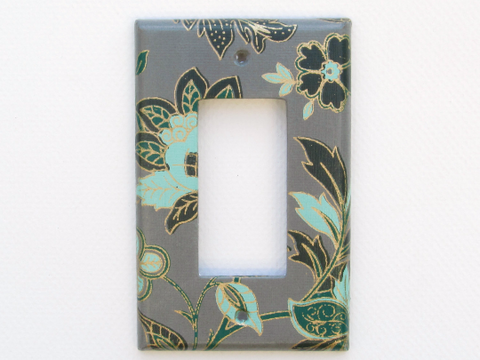 Turquoise and Green Flowers contrast beautifully against the dark background of this Single Dimmer Switch Plate by The Orange Chair Studio.