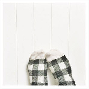 Cozy black and white checkered socks against white background. Image Copyright 2016 Erin Souder.