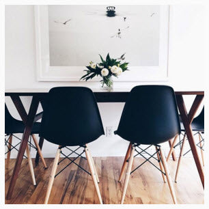 Black table and chairs against white wall. Image Copyright 2015 Liz Bachman.
