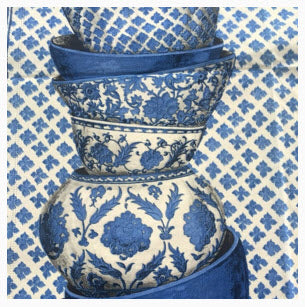 Stacked vintage blue & white patterned bowls against a blue & white diamond checked fabric. Image copyright 2016 Madeline Weinrib.