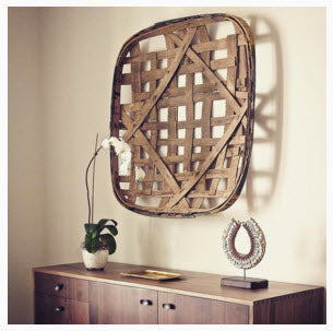 Vintage wooden tobacco basket hanging over modernist wood dresser. Image Copyright 2015 Nicole Facciuto Design.