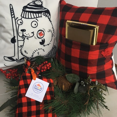 Hockey Beaver pillow showing red and black plaid back cover with pocket.