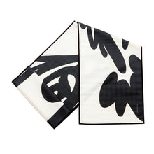 "Load image into Gallery viewer, Fish ""Before"" Table Runner, Black on White, folded"