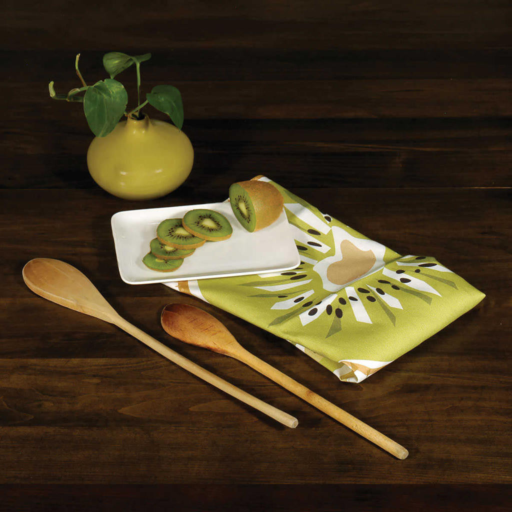 Kiwifruit kitchen towel on table with wooden spoons and vase