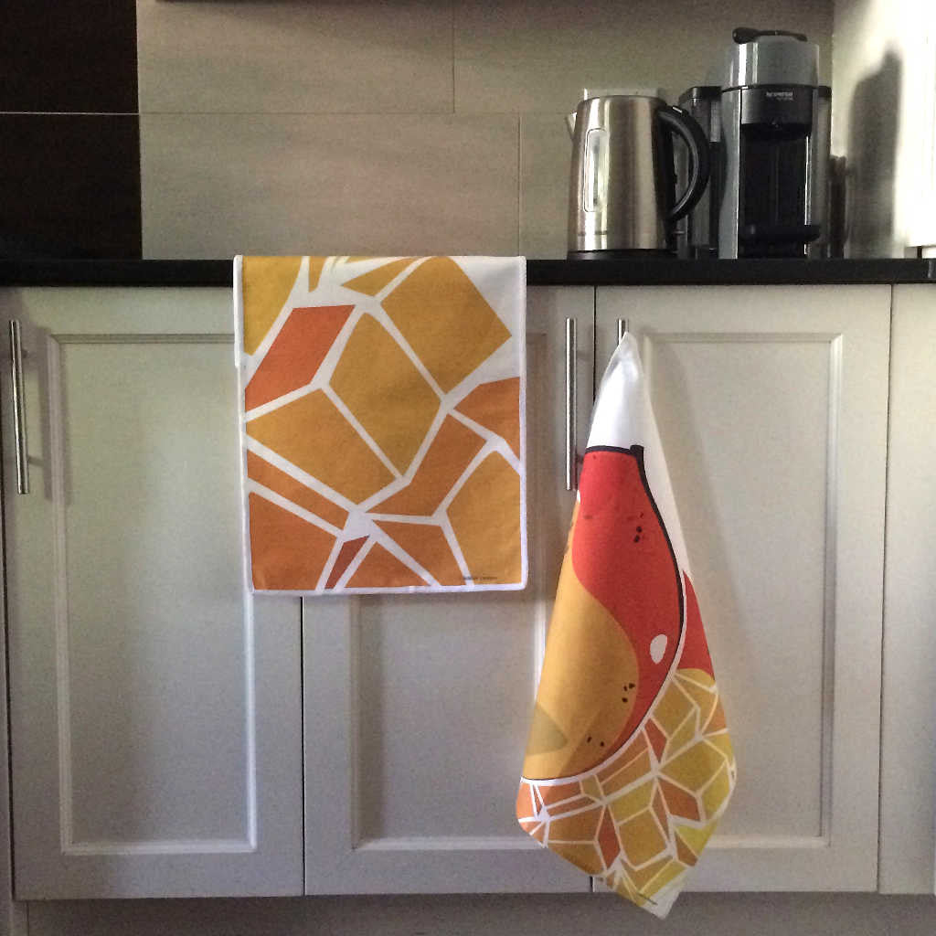 Mango table runner and tea towel displayed in kitchen