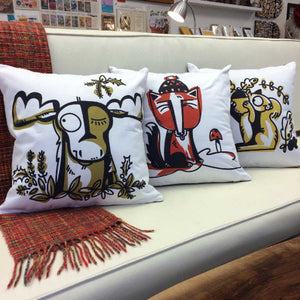 Moose, Fox & Squirrel pillows on white sofa