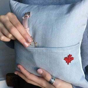 Pillow back showing pocket and embroidered red maple leaf