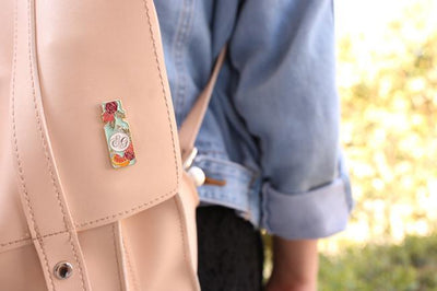 backpack featuring the High quality essential oil pin for clothes and bags by Edens Garden