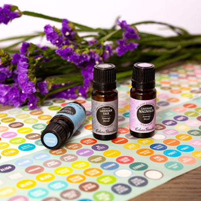color-coded and labeled bottle cap stickers for essential oils by Edens Garden