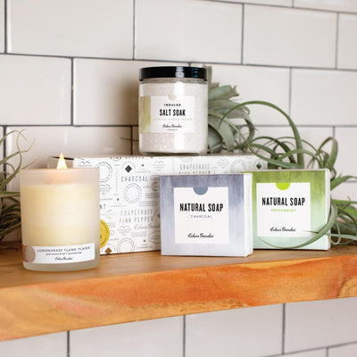 Display of Mix N' Match essential oil set which includes options to choose your own candle, bath salt soak and two bar soaps for a discount by Edens Garden
