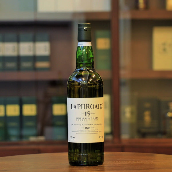 This 15 years Islay single malt whisky from Laphroaig distillery is a 1990s bottling after the Royal Warrant (which was awarded in1994) as is evidenced by the back label. Please note that there is no box available.