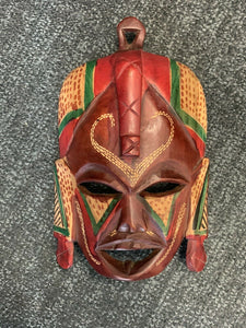 African Imports - Custom Hand Carved Wooden Mask  Detail Coloring Earth Tones, Red, Brown and Mahogany Wood SKU: HANAH11