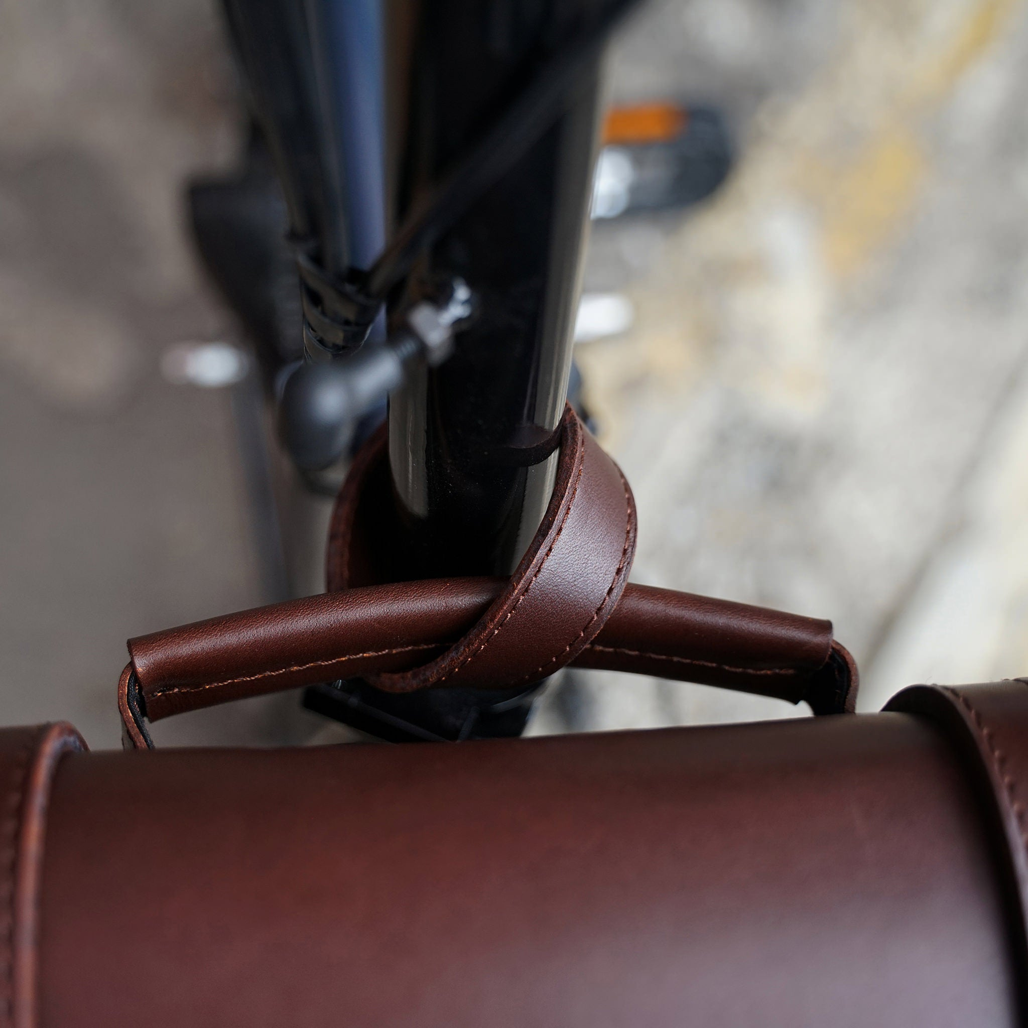 A strap is used to tie the bag/s handle or body strap to your bike.