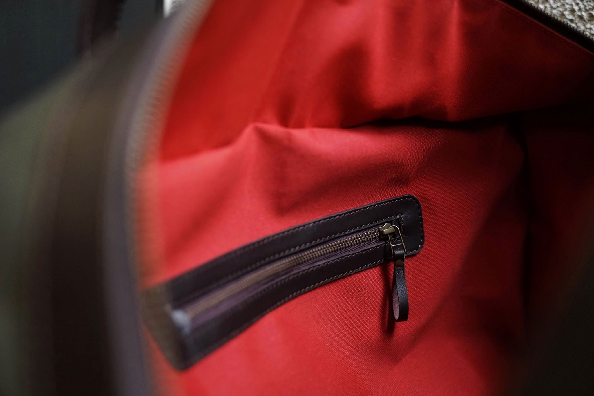One zippered pocket inside.