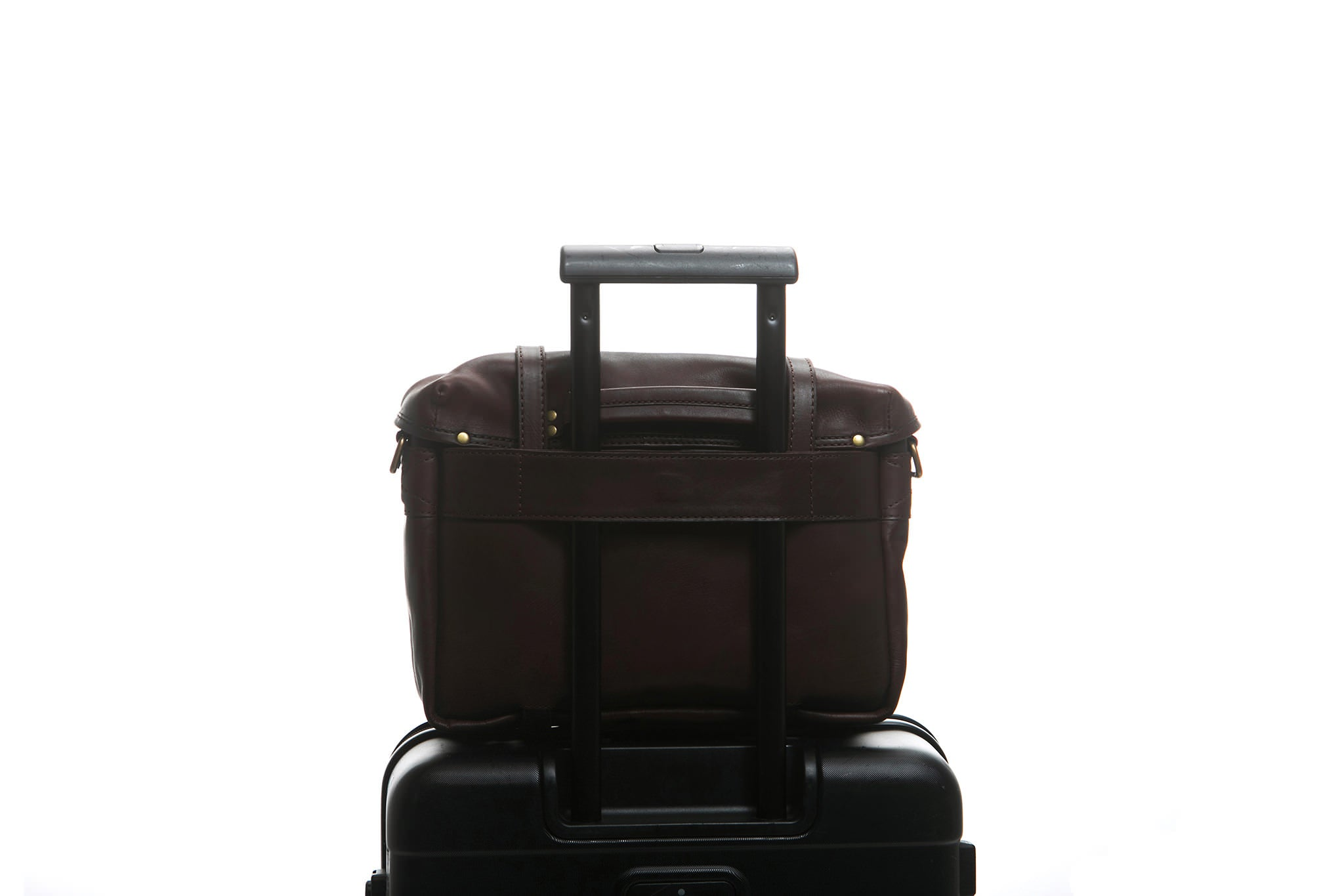 Traveling made easy with a Cravar bag. Shown here with an all leather F.C. bag.