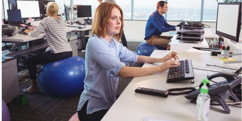 Is it good to sit on an exercise ball