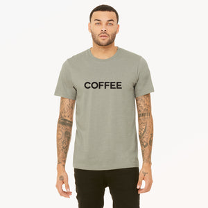 Coffee screenprinted in black on heather stone unisex t-shirt.