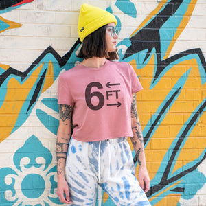 6FT graphic is screenprinted on a mauve women's flowy cropped t-shirt.