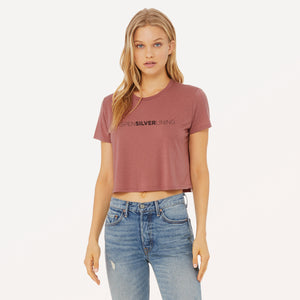 This tee features Aspen Silver Lining graphic screenprinted on a mauve women's flowy cropped t-shirt.