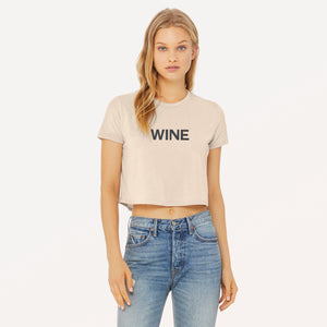 Wine graphic screenprinted on a heather dust women's flowy cropped t-shirt.