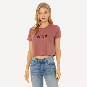 Wine graphic screenprinted on a mauve women's flowy cropped t-shirt.