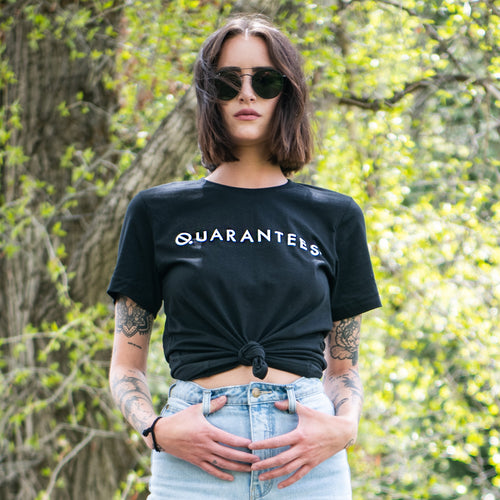Quarantees graphic screenprinted in white on a women's black heather t-shirt