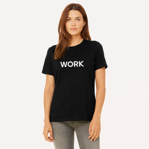 Work graphic screenprinted in white on the front of a black women's relaxed cotton jersey t-shirt.