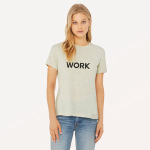 Work graphic screenprinted in black on the front of a heather prism natural women's relaxed cotton jersey t-shirt.