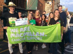 Hogs Back Brewery managing director Rupert Thompson (far left) presents a cheque to Lizzie Armstrong, Relationship Fundraising Manager in the South East (Sussex, Surrey & Kent) for Macmillan Cancer Support