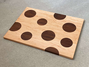 Large rectangular cutting and serving board of maple with large inlaid walnut dots. Pattern is on both sides.