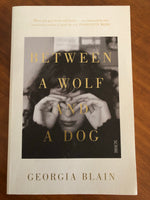 Blain, Georgia - Between a Wolf and a Dog (Trade Paperback)